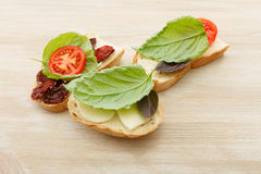 Sandwiches with mascarpone, dried tomatoes, basil Stock Image