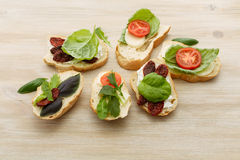 Sandwiches with mascarpone, dried tomatoes, basil Royalty Free Stock Photography