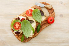 Sandwiches with mascarpone, dried tomatoes, basil Royalty Free Stock Photo