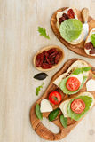 Sandwiches with mascarpone, dried tomatoes, basil Royalty Free Stock Images