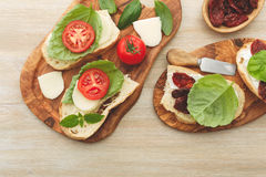 Sandwiches with mascarpone, dried tomatoes, basil Royalty Free Stock Image