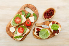 Sandwiches with mascarpone, dried tomatoes, basil Stock Photos