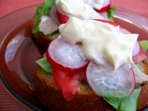 Sandwiches with mayonnaise. Fresh spring time sandwiches: bread, butter, lettuce, pork, tomato, radish and mayonnaise stock images