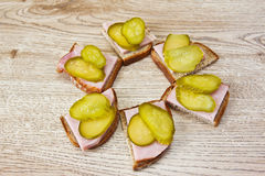 Sandwiches with meat and marinated cucumbers. Sandwiches with smoked meat and marinated cucumbers Royalty Free Stock Photo