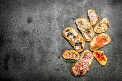 Sandwiches with meat, salami, seafood and fresh vegetables. stock photo
