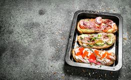 Sandwiches with meat, salami, seafood and fresh vegetables. stock photography