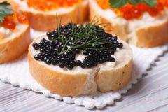 Sandwiches met de zwarte macro van kaviaarvissen royalty-vrije stock foto