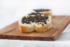 3 sandwiches met zwarte kaviaar Royalty-vrije Stock Afbeeldingen