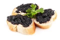 Sandwiches met zwarte kaviaar die op wit wordt geïsoleerd Royalty-vrije Stock Foto