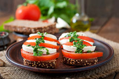 Sandwiches with mozzarella, tomatoes and rye bread Royalty Free Stock Photo