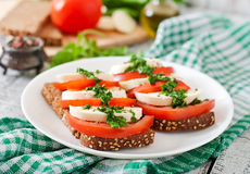 Sandwiches with mozzarella, tomatoes and rye bread Stock Photos