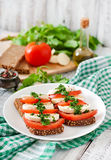 Sandwiches with mozzarella, tomatoes and rye bread Royalty Free Stock Photography