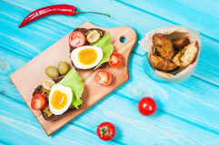 Sandwiches with olive, quail eggs, cherry tomatoes and potatoes. On a wooden blueboard. Delicious healthy snack or Breakfast Royalty Free Stock Images