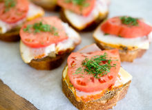 Sandwiches on paper Stock Image