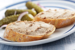 Sandwiches with pate. And  pickled cucumbers on the plate Stock Photos