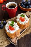 Sandwiches with pate cheese, garlic, slices of pepper, dill. A cup of coffee. Stock Photos