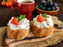Sandwiches with pate cheese, garlic, slices of pepper, dill. A cup of coffee. Stock Photography