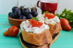 Sandwiches with pate cheese, garlic, slices of pepper, dill. A cup of coffee. Royalty Free Stock Photos