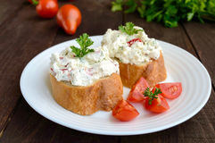 Sandwiches with pate cheese, garlic, slices of pepper, dill. Organic health food. Stock Images
