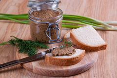 Sandwiches with pate, with glass jar on a background Stock Images