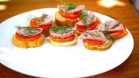 Sandwiches with pate, tomatoes, sausage take off stock video