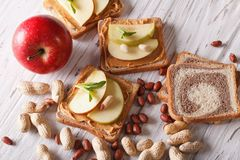 Sandwiches with peanut butter and an apple. Horizontal top view Stock Photography