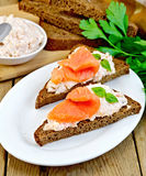 Sandwiches on pieces of bread with salmon Stock Images