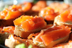 Sandwiches with pink salmon on a plate. On a festive table Stock Photography