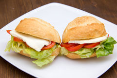 Sandwiches on plate over wood close Royalty Free Stock Photo