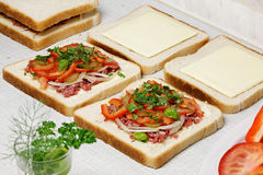 Sandwiches preparation. Royalty Free Stock Images