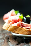 Sandwiches with prosciutto olive on plate vertical Stock Image