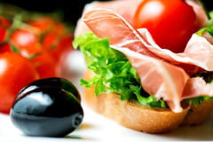 Sandwiches with prosciutto on plate with olive horizontal Stock Photography
