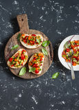 Sandwiches with quick ratatouille on rustic cutting board on a dark background. Delicious healthy vegetarian food. Top view Royalty Free Stock Photos