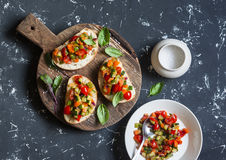 Sandwiches with quick ratatouille on rustic cutting board on a dark background. Delicious healthy vegetarian food. Royalty Free Stock Photos