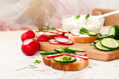 Sandwiches with radish and sour cream sauce. Spring snacks sandwiches with radish, cucumber and cream sauce. cream cheese with a plate and parsley Stock Photo