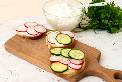 Sandwiches with radish and sour cream sauce Stock Photo