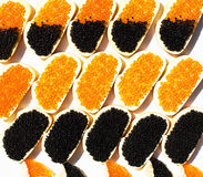Sandwiches with red and black caviar Royalty Free Stock Image