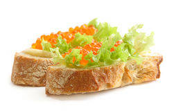 Sandwiches with red caviar Stock Images
