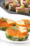 Sandwiches with red caviar. On white background Royalty Free Stock Photos