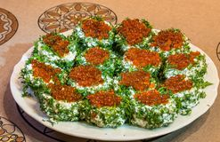 Sandwiches with red caviar and greens on a plate royalty free stock photos