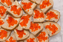 Sandwiches with red caviar on a plate. Stock Photography