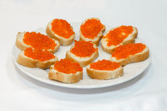 Sandwiches with red caviar. Stock Photo