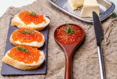 Sandwiches with red caviar, spoon Stock Photography