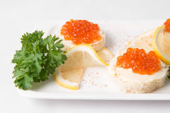 Sandwiches with red caviar. On white plate Stock Photo