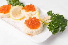 Sandwiches with red caviar. On white plate Stock Images