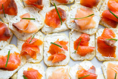 Sandwiches with red fish. On crackers Royalty Free Stock Image
