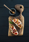 Sandwiches with ricotta, fresh figs, walnuts and Royalty Free Stock Images
