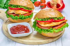 Sandwiches with roast chicken fillet, tomato and paprika. On wooden board Royalty Free Stock Photos