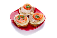 Sandwiches with roast pork, cheese and tomato Royalty Free Stock Image