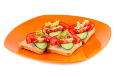 Sandwiches. Rusk sandwiches with lettuce, cucumber on plate isolated on white background royalty free stock image